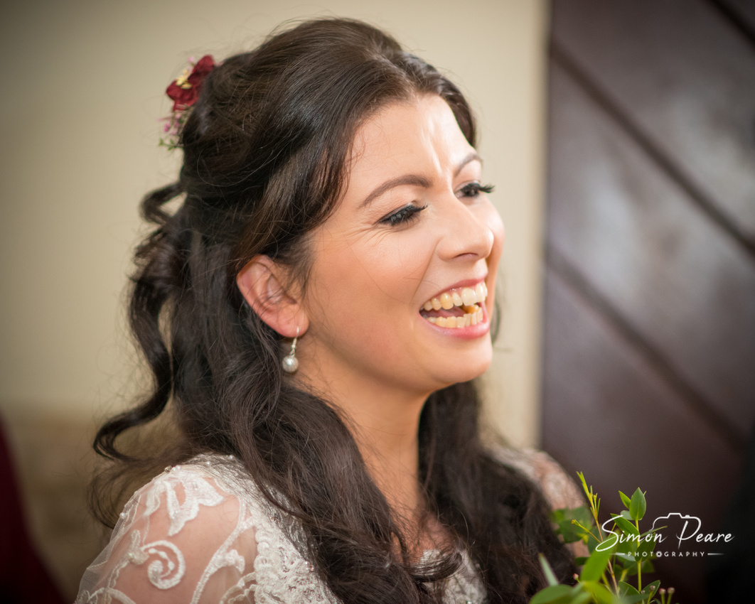 Documentary Wedding Photography - Natural Unposed Images. People Look Their Best When They Are Relaxed. Erin smiling after the ceremony greeting her guests