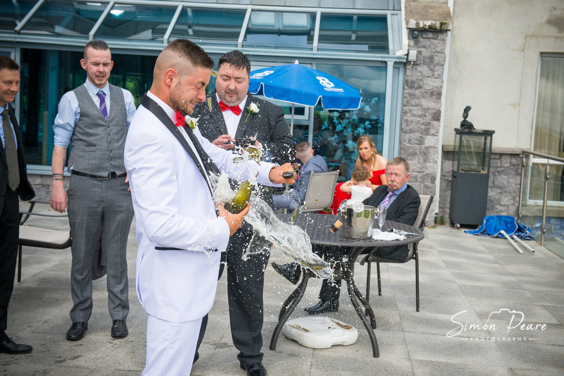 Sharon and Kevin Wedding Photos Glasson Country House. Break open the champagne on your wedding day