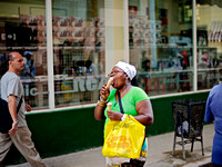 Fine Art Photograph and Print of a Lady Eating Two Ice Creams Havana, Cuba by Dublin Photographer Simon Peare